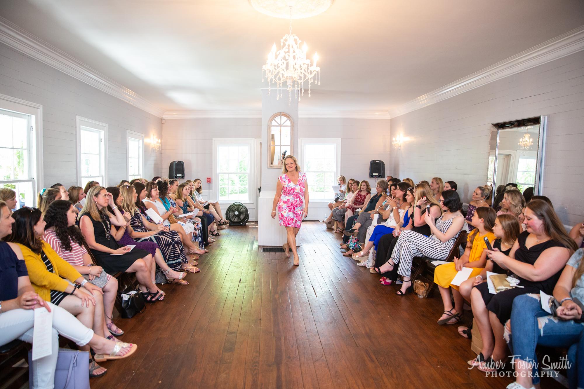 Women walking a runway in fashion show