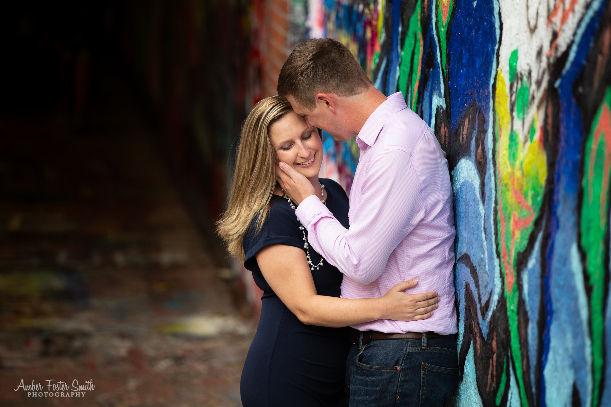 Engaged couple hugging at Free Expression Tunnel