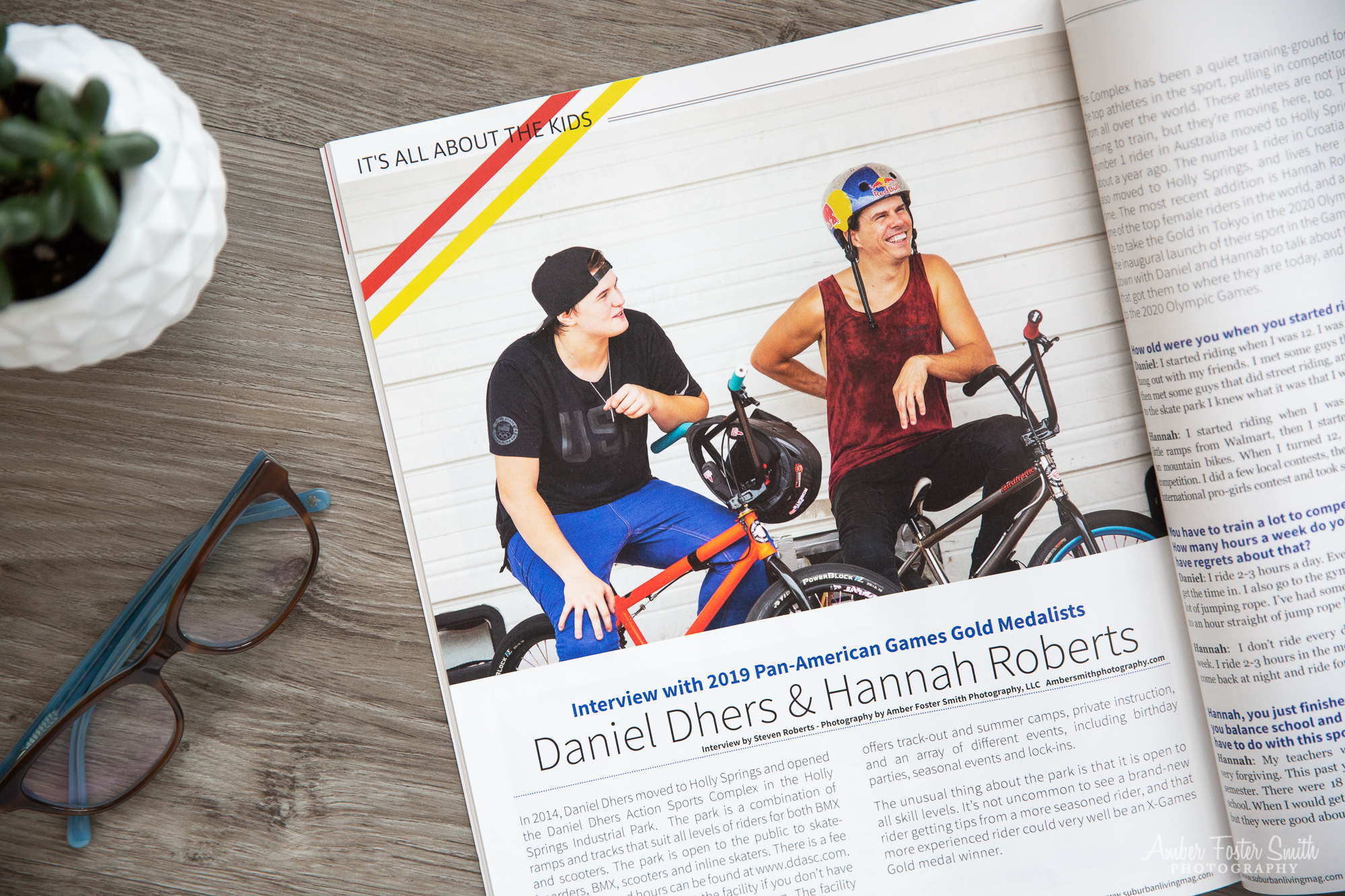 Magazine opened with pages showing two people on bikes