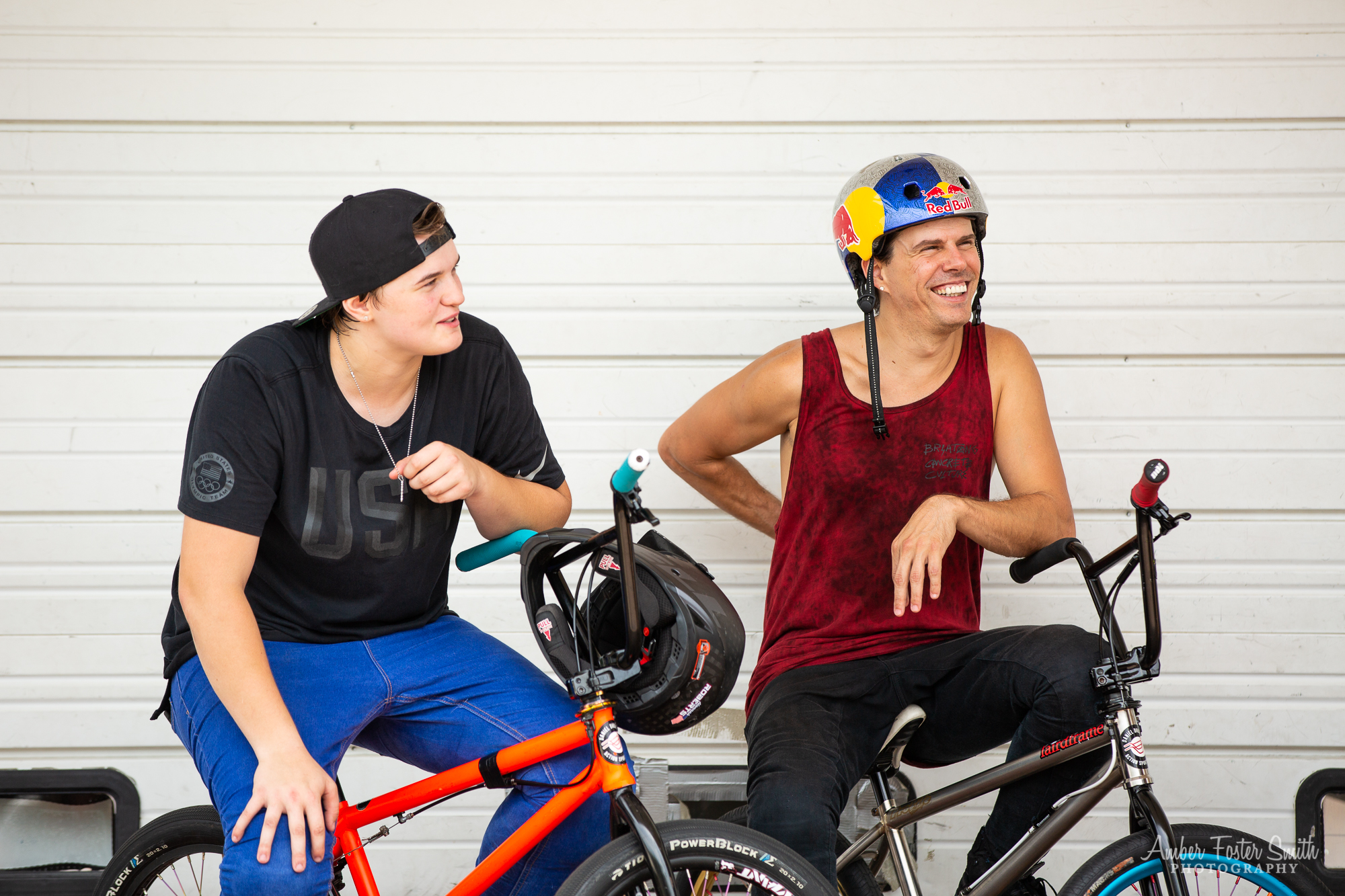 Two people sitting on bikes during an interview