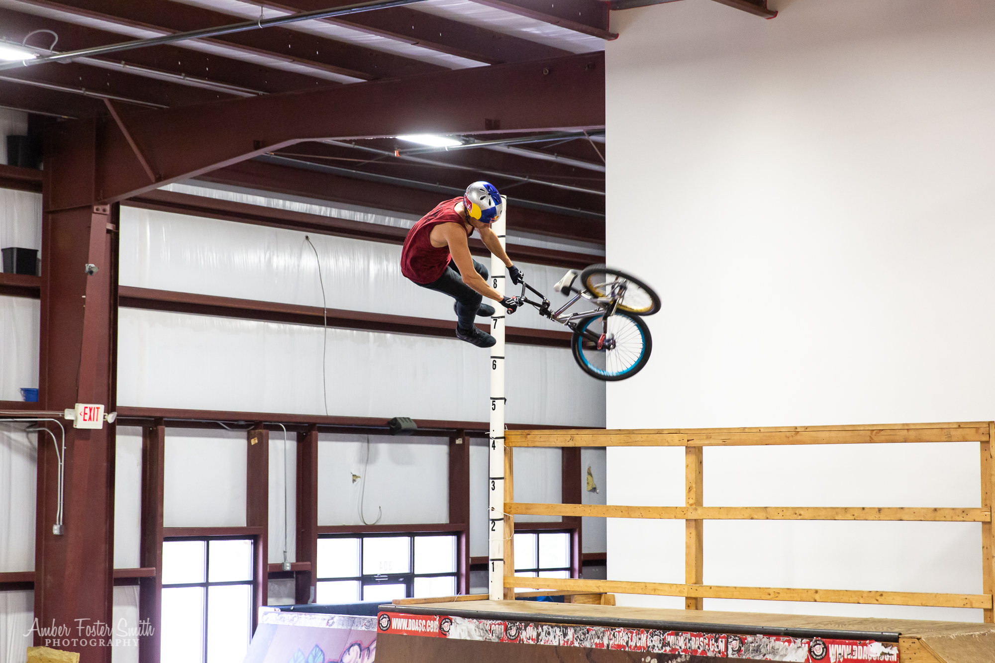 Man on BMX bike doing a flip on a half pipe