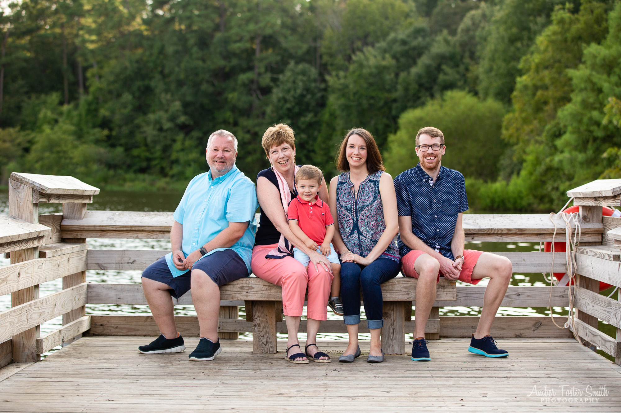 family of five sitting on a dock