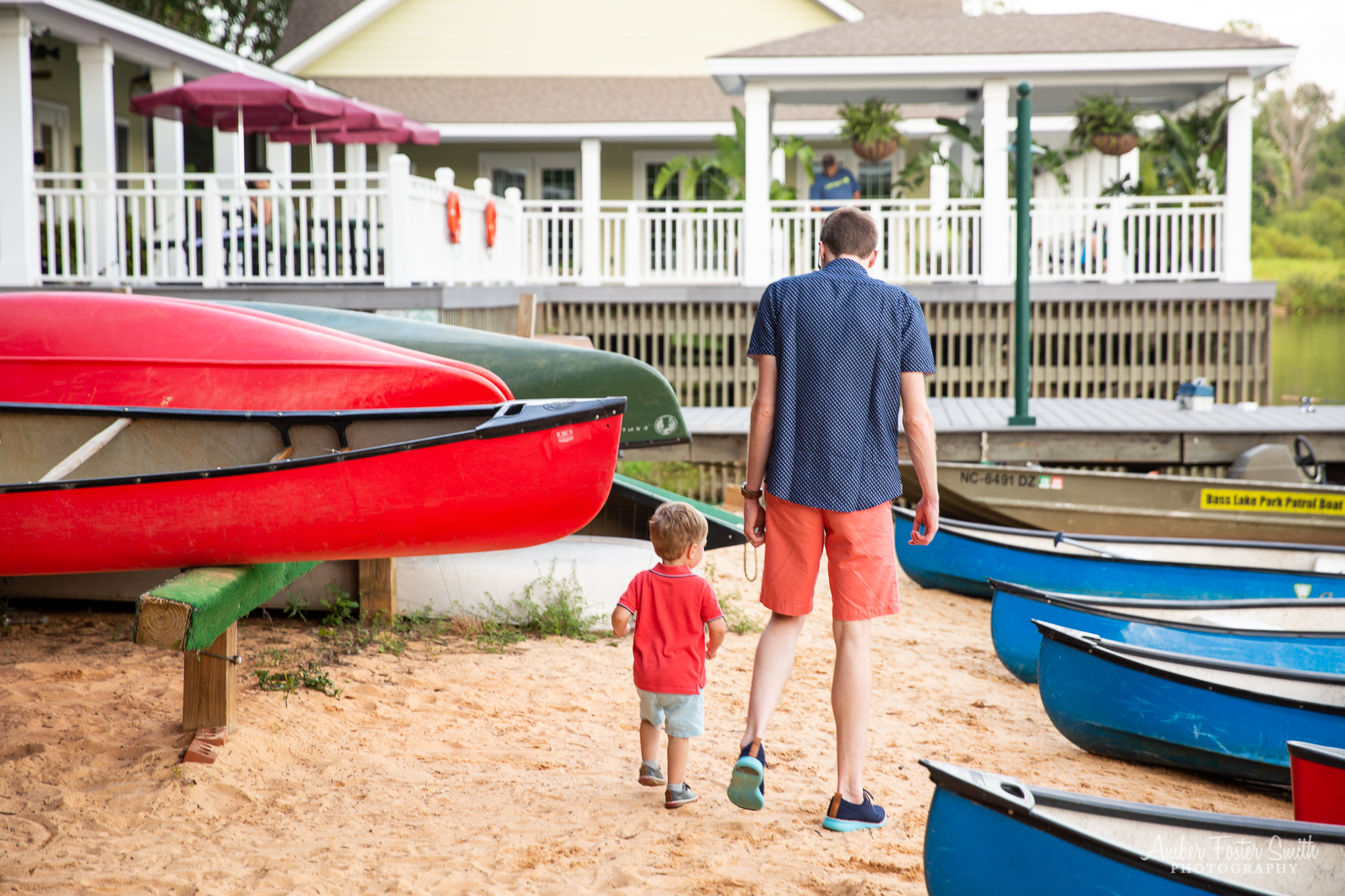 little boy with dad by boats