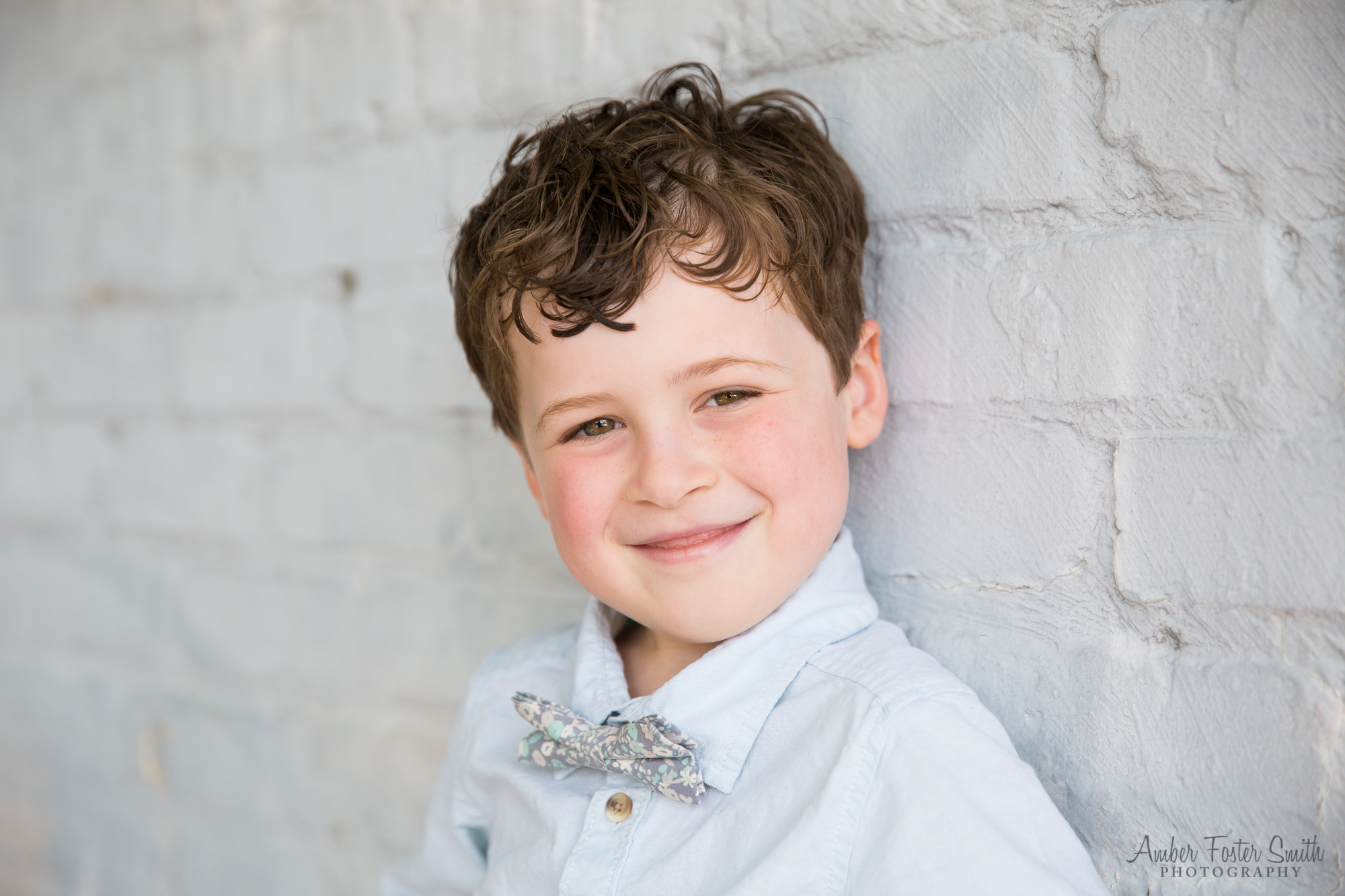 little boy in bow tie smiling