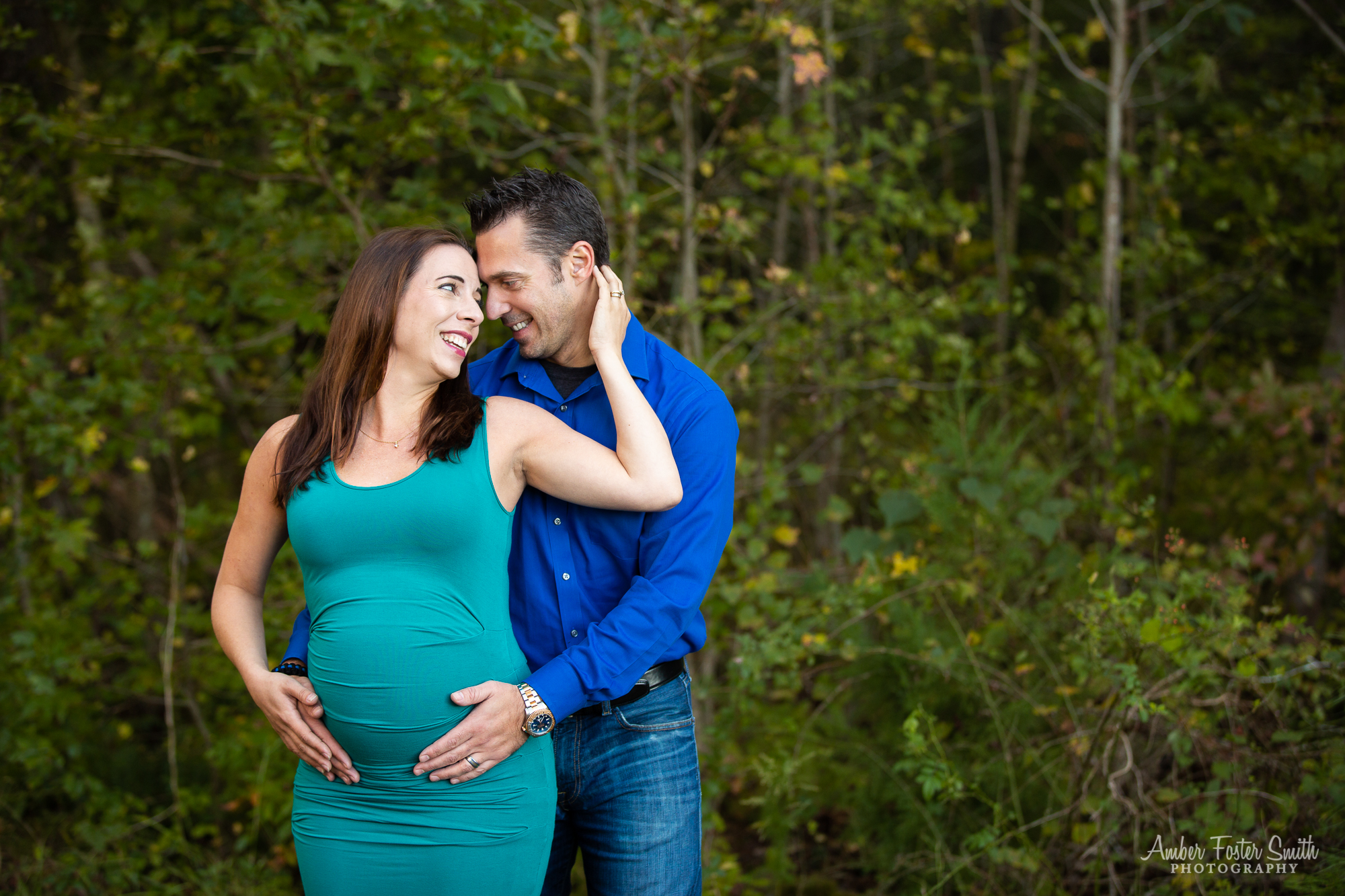 Pregnant woman and man holding each other