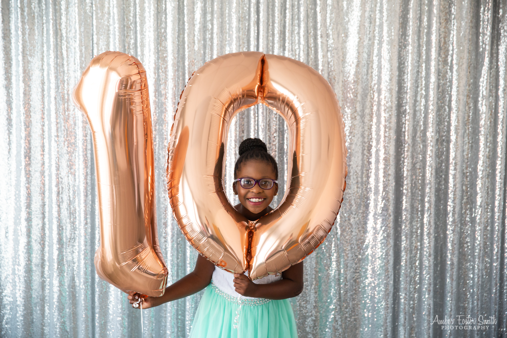 Girl with balloons in shape of number 10